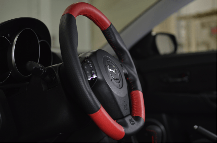 Increase your Mazdaspeed's handling and style with this new leather steering wheel.