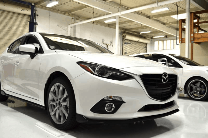 We're going to take apart and upgrade a brand new Mazda 3 with a SkyActiv manual transmission.