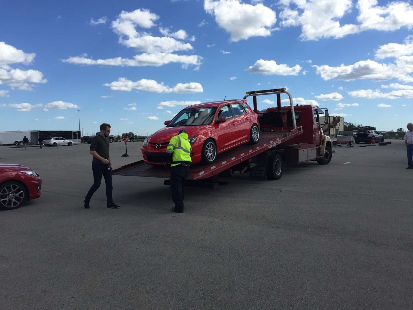 A Mazdaspeed gets towed from a NATOR event.