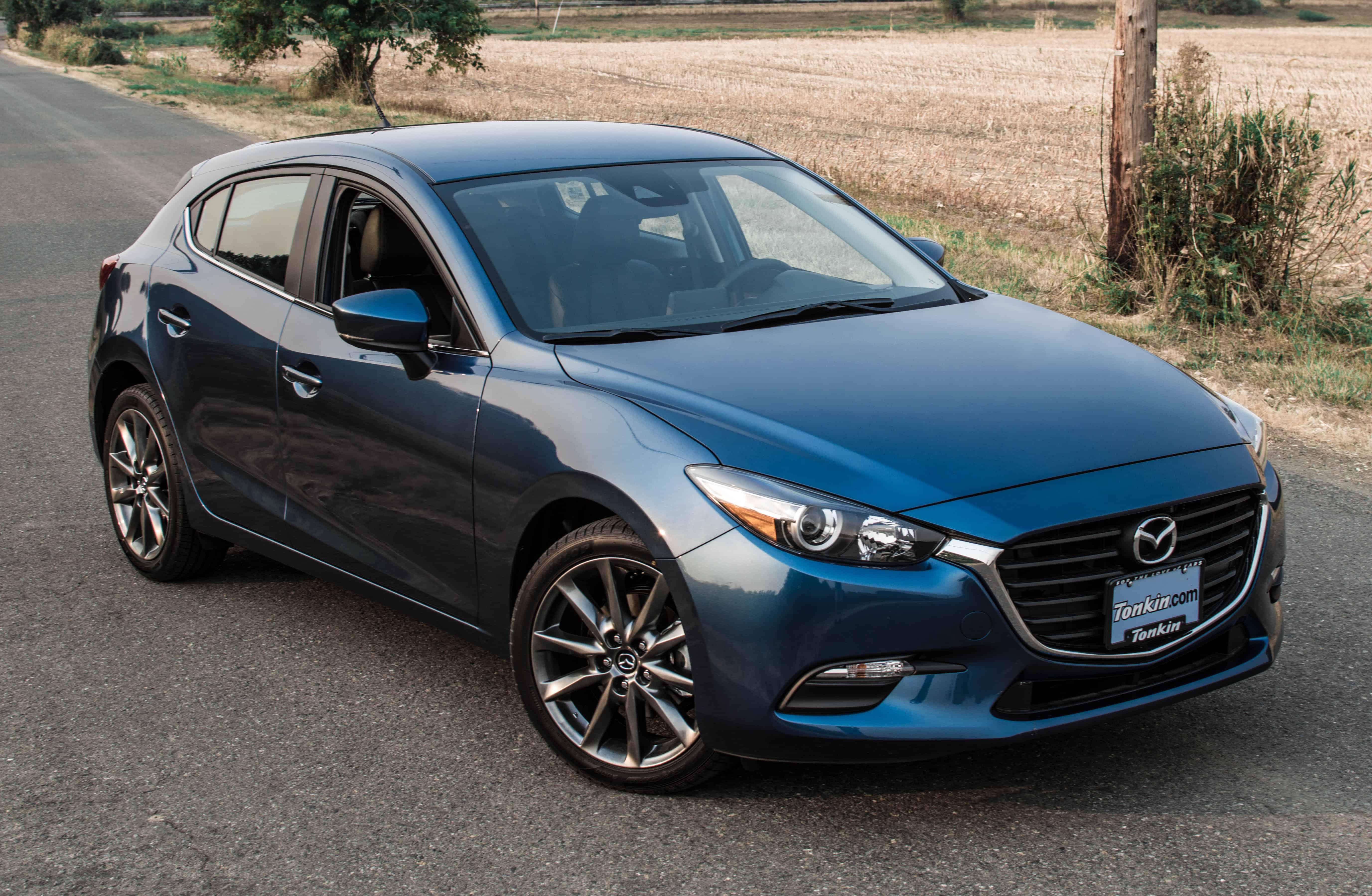 FACEOFF: 2018 Mazda 3 Touring vs 2017 Honda Civic Hatchback Sport